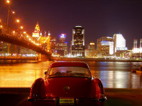 Cincinnati by twilight, with Corvette