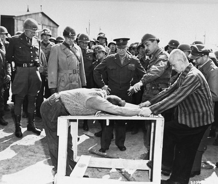 Eisenhower viewing a demonstration of Nazi torture methods at Buchenwald. We executed them.